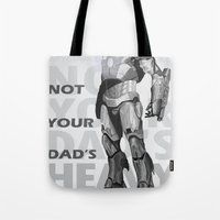 heavy metal Tote Bags featuring Heavy Metal by Laura Stephens