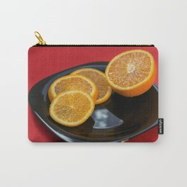 Sliced orange on the black plate and red background Carry-All Pouch