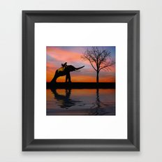 silhouettes at sunset Framed Art Print
