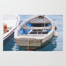 Little fishing boat, blue sea Rug