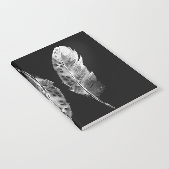 Three feathers on black background Notebook