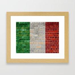 Italy flag on a brick wall Framed Art Print
