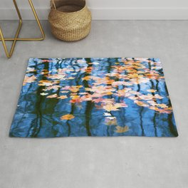 Fallen leaves in water Rug