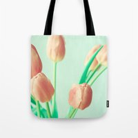 pushing daisies Tote Bags featuring Gravity's Pushing by Caroline Mint