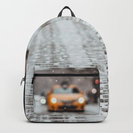 Yellow cab during snow Backpack