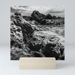 Landscape of sea rocks and sand. Mini Art Print