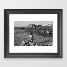 on the rocks by the sea Framed Art Print