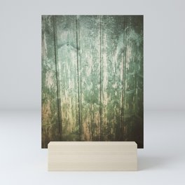 Green and dirty background of wooden planks Mini Art Print