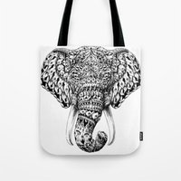 bioworkz Tote Bags featuring Ornate Elephant Head by BIOWORKZ