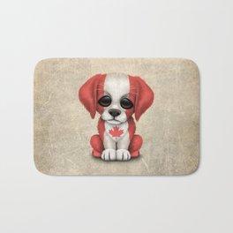 Cute Puppy Dog with flag of Canada Bath Mat