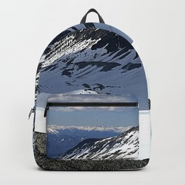 Mountains dappled with snow and rock Backpack