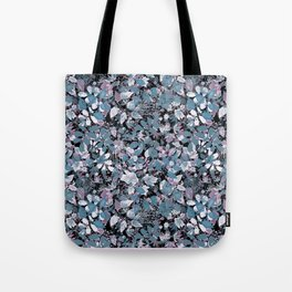 Openwork blue and purple leaves on a black background . Tote Bag