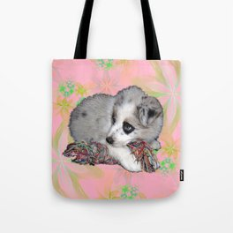 fluffy puppy on flower background Tote Bag