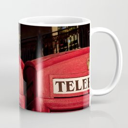 Approaching the roof of two typical English telephone booths. Coffee Mug