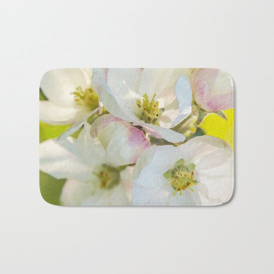 Close-up of Apple tree flowers on a vivid green background - Summer atmosphere Bath Mat