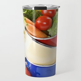Ratatouille or soup vegetables in a cooking pot over white Travel Mug
