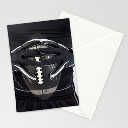 Black gloved hands holding a black American Football Stationery Cards