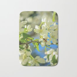 A bee and apple blossoms Bath Mat