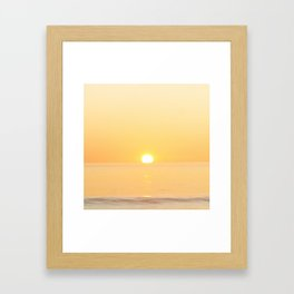 Peachy sunrise seascape Framed Art Print