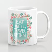 eat Mugs featuring Eat Well, Travel Often Bouquet  by Cat Coquillette