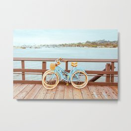 Two retro bicycles standing on Santa Barbara pier, California, USA. Vintage filter with muted teal blue and orange colors. Metal Print