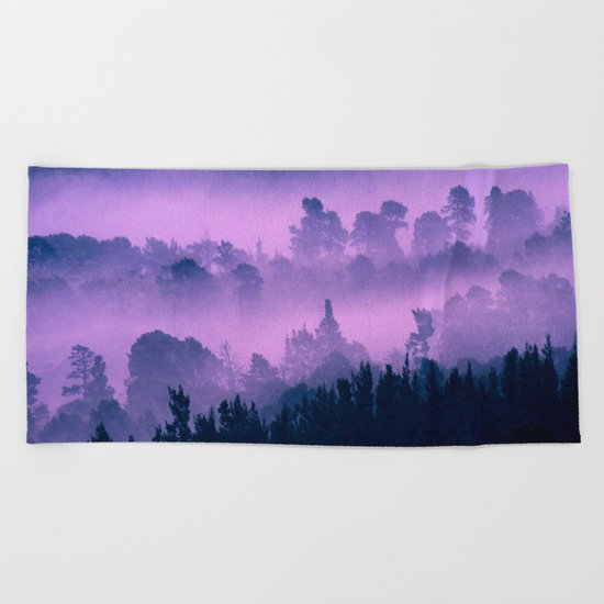Blue forest in a pink fog Beach Towel