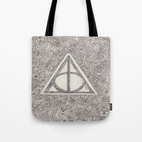 deathly hallows Tote Bags featuring deathly hallows by Clara Lucie P