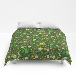 Yellow buttercup and daisies with wild strawberries on grass Comforters