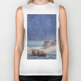 Small boat and waves crashing over rocks Biker Tank