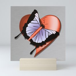 Beautiful butterfly and heart on polished metal textured background Mini Art Print