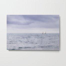 Sailing the ocean blue; two sailboats on the horizon Metal Print