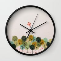 wind Wall Clocks featuring Wind by carosurreal