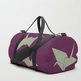 Origami paper cranes on purple waves Duffle Bag