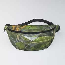 Yellow flower in the rain forest Fanny Pack