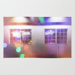 restaurant in the city with the colorful night light bokeh abstract Rug