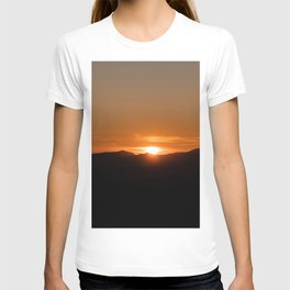 Orange sunrise on black mountains T-shirt