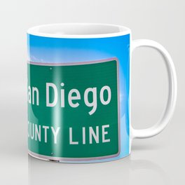Closeup of the San Diego County Line Sign against a Blue Sky in the Anza Borrego Desert State Park Coffee Mug