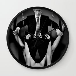 Bondage bdsm scene with a nude woman and an sexy older man Wall Clock
