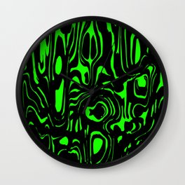 A twisted interweaving of green spots from flowing lava and a light chaotic cycle. Wall Clock