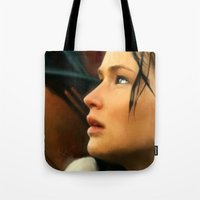 katniss Tote Bags featuring Katniss by Kate Dunn
