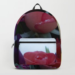 Vibrant bouquet of flowers in the snow Backpack