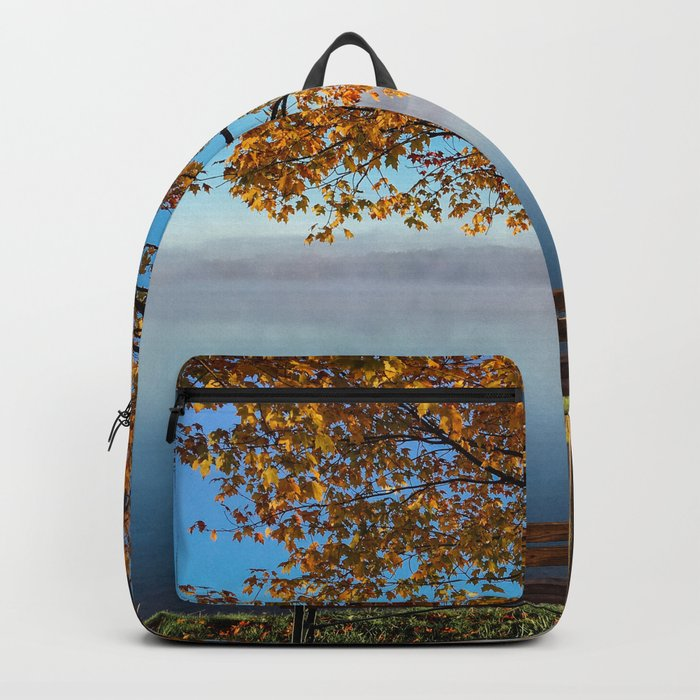 Autumn bench by the lake Backpack