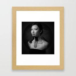 The dark muse Framed Art Print