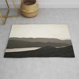Mountains and a lake Rug