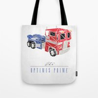 optimus prime Tote Bags featuring The Optimus Prime by Josh Ln