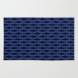 Sardines, black on blue Rug