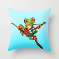 palestine Throw Pillows featuring Tree Frog Playing Acoustic Guitar with Flag of Palestine by Jeff Bartels