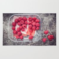 baking Area & Throw Rugs featuring Raspberries in plastic container on old metal baking tray by Elisabeth Coelfen