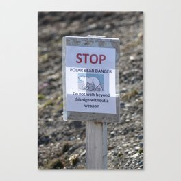 Stop - Polar bear danger - Do not walk beyond this sign without a weapon Canvas Print