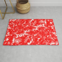 A bright cluster of red bodies on a light background. Rug